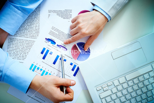 CloseUp Of Female Hand Pointing At Business Document While