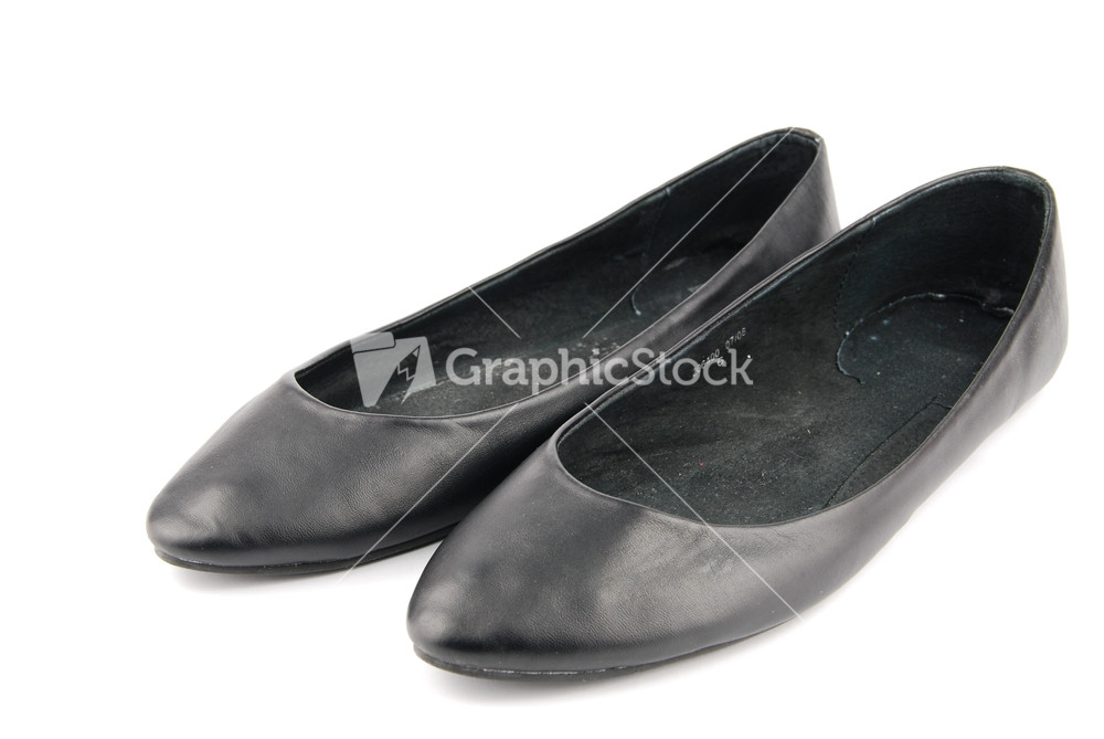 black leather ballet flat shoes on white stock image
