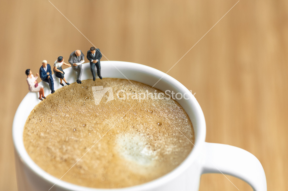 Miniature Business Team Having A Coffee Break Stock Image