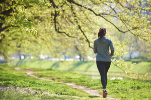 Woman jogging in park at morning