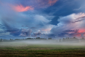 Sunset Over A Misty Field In Countryside Latvia
