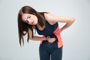 Fitness woman having pain in stomach