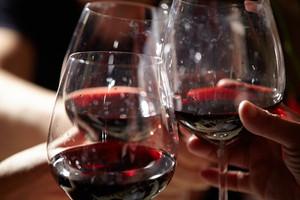 Three red wine glasses.