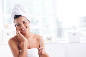 Girl With A Towel On Her Head And Body Speaking By The Phone And Looking At Camera