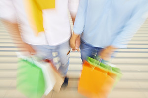 Blurred Image Of Couple With Shopping Bags