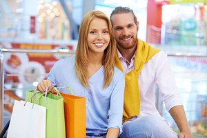Portrait Of A Young Couple With Shopping Bags