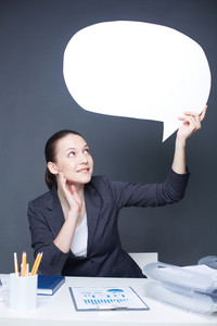 Image Of Happy Businesswoman Looking At Paper Speech Bubble In Her Hand