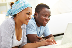 Image Of Young African Couple Networking At Home