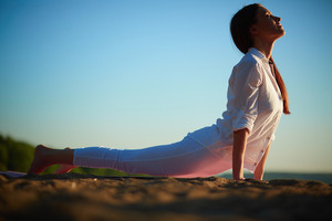 Photo Of Active And Fit Girl Doing Stretching Exercise On Sandy Beach
