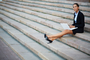 Image Of Young Businesswoman In Suit Networking On Steps Of Building