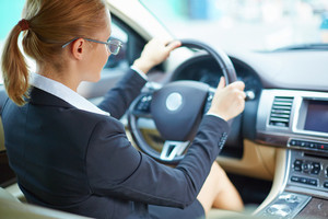 Young Businesswoman Driving Car