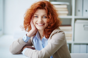 Portrait Of A Woman With Bright Red Hair
