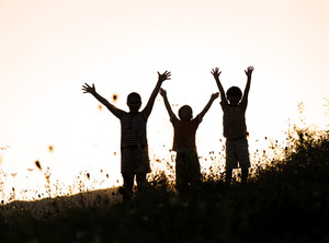 Happy children in nature at sunset