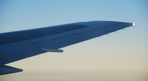 Airplane Wing View At Sunset