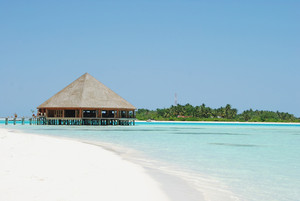 Bungalow's Architecture And Beach On A Maldivian Island