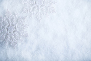Two beautiful sparkling vintage snowflakes on a white frost snow background. Winter and Christmas concept.