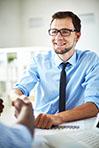 Smiling Businessman Handshaking With Partner After Negotiations