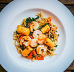 Italian Pasta With Shrimp And Vegetables On Wooden Background